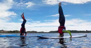 stand-up-paddleboard-yoga-cornwall-headstand-1024x768
